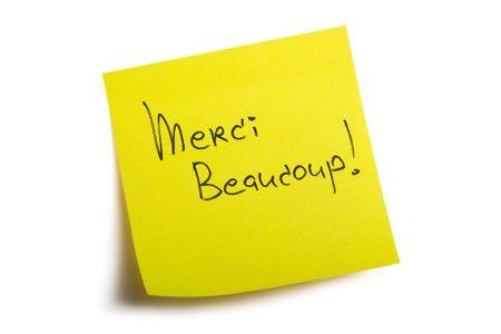 scrawl: Merci beaucoup! Sticky nota. Isolato su sfondo bianco, con percorso di clipping.