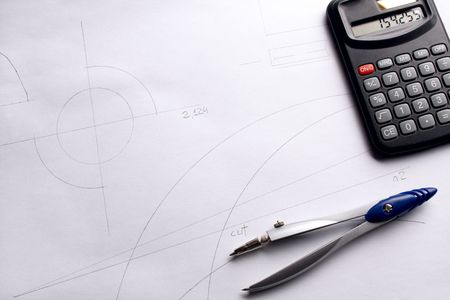 drawing compass: Drawing compass and calculator on blueprint background. Stock Photo