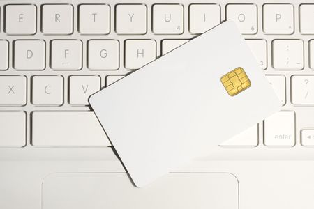 smart card: Modern security. Smart card close-up on white laptop. Stock Photo
