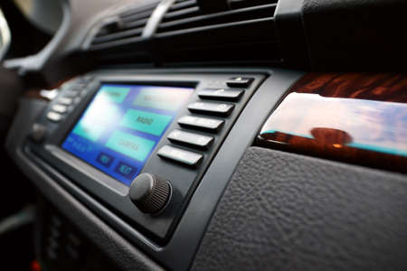 Modern luxury cars dashboard, with multifunctional display. Shallow DOF. Stock Photo