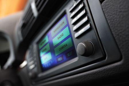 Modern car interior with multifunctional display. Shallow DOF. Stock Photo