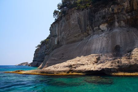 Mediterranean seascape. Rocks, sea and clear sky in sunny summer day. Stock Photo - 5033592