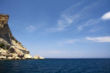 Mediterranean seascape. Rocks, sea and sky in sunny summer day. Stock Photo - 5049851