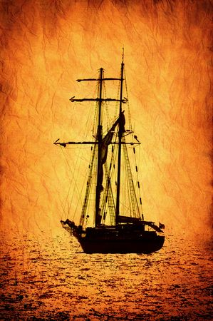 Old crumpled brown parchment pattern with sailer ship image.. photo