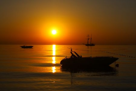 Sunrise seascape. Sailing ship and boat at dawn. Stock Photo - 5204160