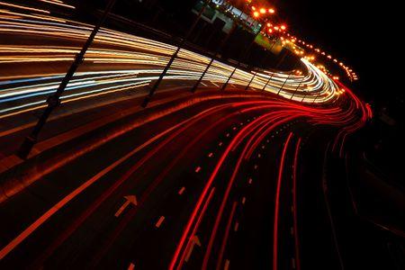 Nigh city highway. Headlights on the road Stock Photo - 5227840