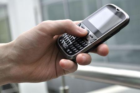 Modern business class smartphone in man hand.