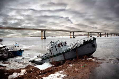 Abandoned wrecked boat at river coastline. Stock Photo - 6511751