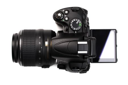 digicam: Modern DSLR camera with open vari-angle monitor. Top view. Isolated on white background. Stock Photo