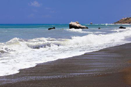 Sandy bank and foamy marine waves on a background rocks. Petra Tou Romiou - AphroditeÕs Rock. Cyprus. Stock Photo - 7249833