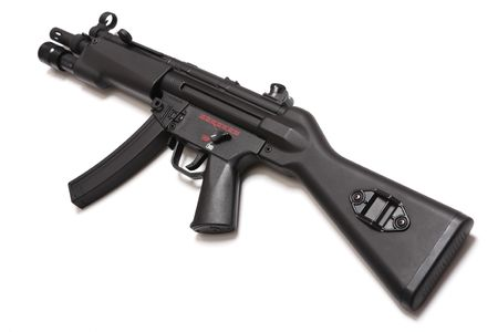 airsoft: MP5 - legendary submachine gun with tactical flashligt. Tilt view. Isolated on a white background. Weapon series.
