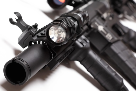 carbine: M4A1 carbine with RISRAS forearm and tactical flashlight. Shallow DOF.