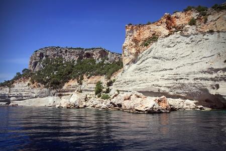 Mediterranean rock coast in a summer day. Stock Photo - 11085877