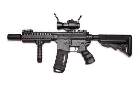 assault rifle: Custom build compact size M4A1 assault carbine with RISRAS, tactical handguard, crane stock and red-dot sight. Isolated on a white background. Weapon series. Stock Photo