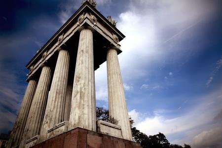 volgograd: Colonnade with soviet symbols on the background of dramatic sky. Volgograd, Russia.