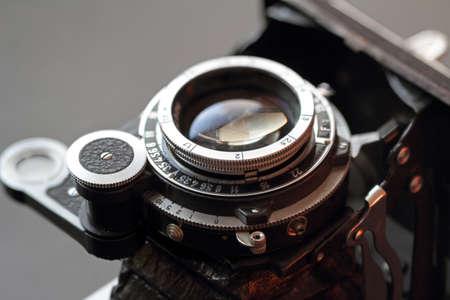 studio photography: An old camera lens close-up.