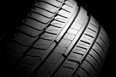 summer tire: Modern high-performance sport summer tire on a black background  Low key scene  Stock Photo