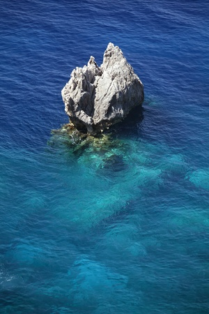 Rock in the sea near Paleokastritsa, Corfu Island, Greece  Stock Photo - 15111065