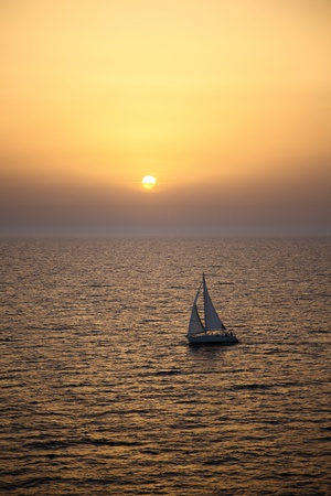 Yacht sailing at sunset near Bari. Italy. photo