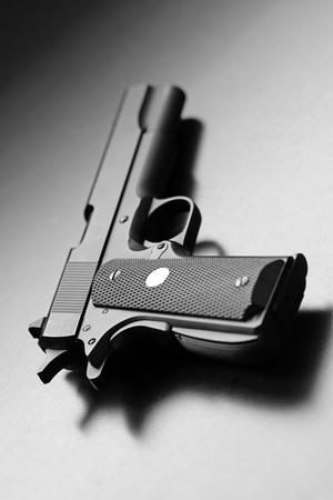 handgun: Legendary M1911, .45 caliber pistol. Studio shot. Shallow DOF.