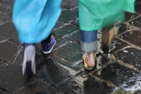 Two women walking in the rain in Florence, Italy. Stock Photo - 17093785