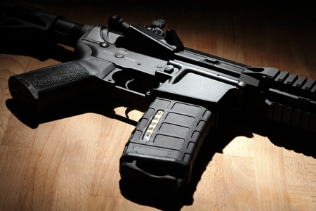 carbine: Weapon series. Custom build AR-15 (M4A1) carbine on a wooden surface. Studio shot. Stock Photo