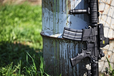 carbine: An AR-15 assault carbine (M4A1) about old petrol can Stock Photo