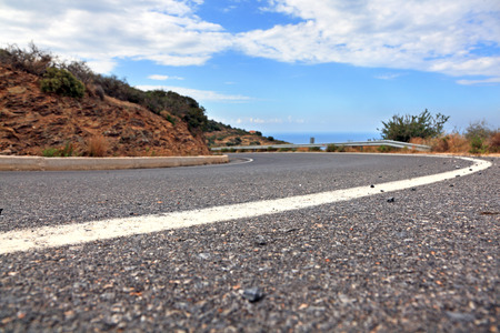 asphalt road: Mountain road in Crete, Greece  Low angle view  Shallow DOF  Stock Photo