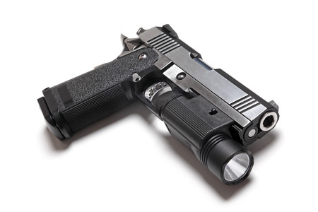 45 caliber: Custom Build 1911 Double Stack USPSA Pistol With Flashlight Stock Photo