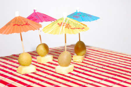 tropicana: Tropicana: Olives with cheese under umbrellas   Stock Photo