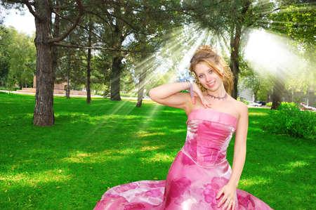 Happy pretty bride in sunbeams photo