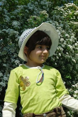 prety: prety child in hat Stock Photo