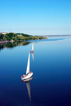 bird fly view on calm river photo