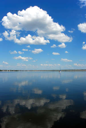cloudy blue sky reflection in calm water Stock Photo - 3269158