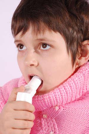 child with inhaler does medicine procedure photo
