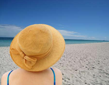 women in hat on ocean background photo