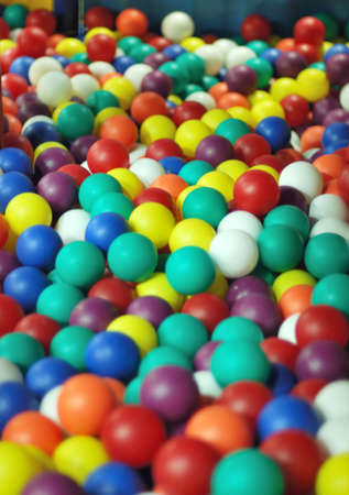 playcentre: Colored playing balls.Focused on center line. Stock Photo