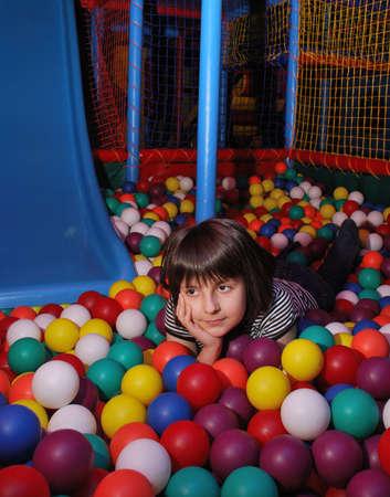 playcentre: pretty child in colored balls