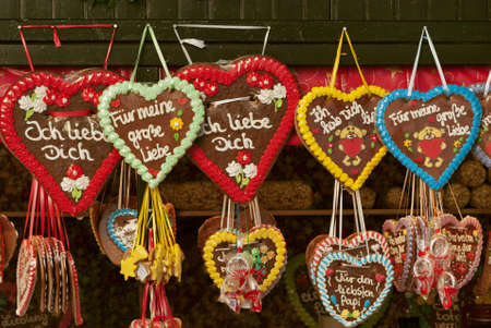 Colorful traditional gingerbread hearts at Christmas market in Germany