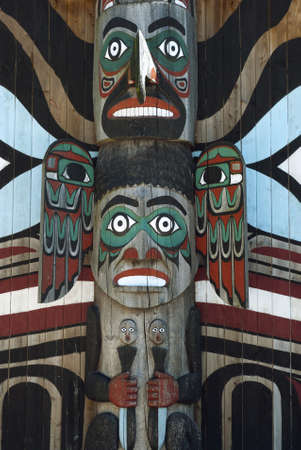 Wooden totem pole, monumental sculpture carved from large tree