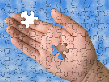 Hand from puzzle without one piece (it layz on  palm), sky background Stock Photo - 626280