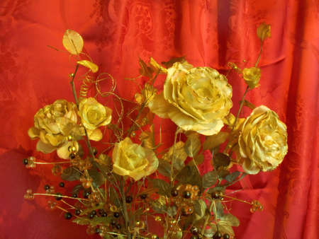 Golden roses on red background photo