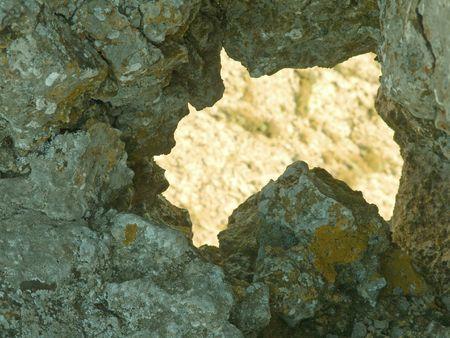 thorough: Big thorough crack in rock Stock Photo
