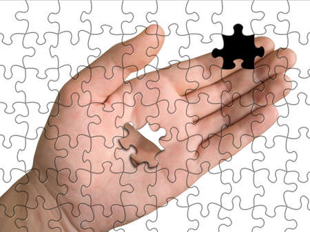 Hand from puzzle without one piece (it layz on  palm), white background Stock Photo - 695776