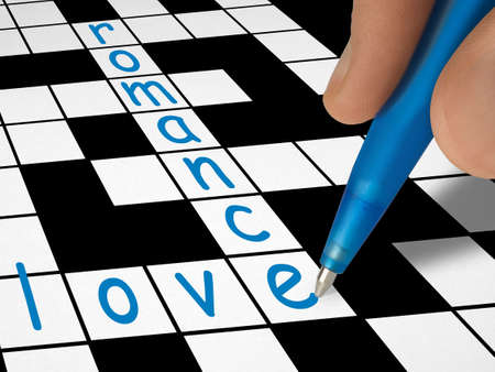 Crossword - love and romance, hand with pen photo