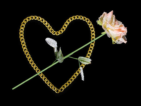 Golden heart and rose, isolated on black photo