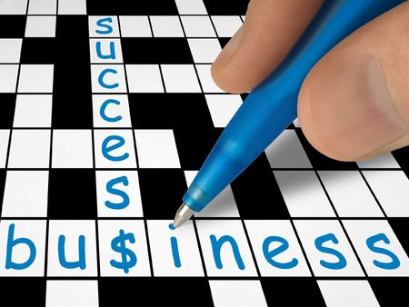 Crossword - business and success, hand with pen Stock Photo - 769156