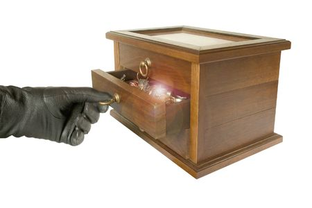 Hand in black glove opening casket with jewelry, isolated Stock Photo - 769224