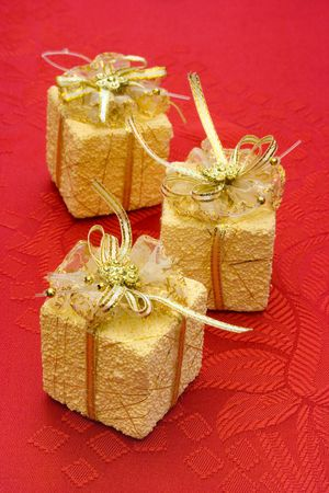 Three gifts on red background with flowers Stock Photo - 769465