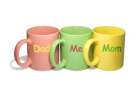 earthenware: Three colorful mugs -  Dad, Me, Mom (family), isolated on white